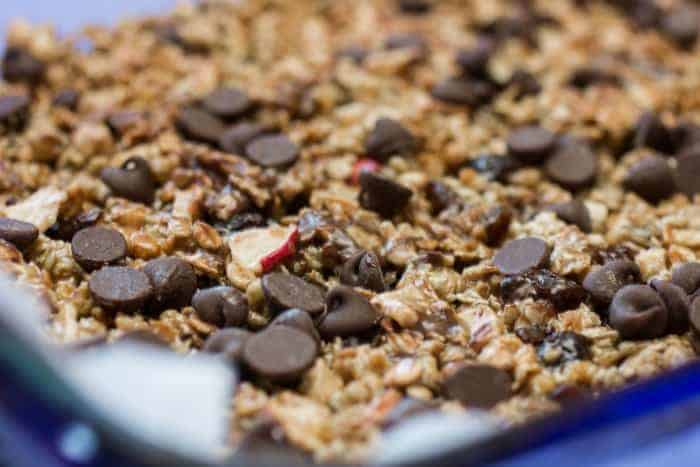 Chocolate Raisin Apple Granola Bars in a pan. Recipe Included