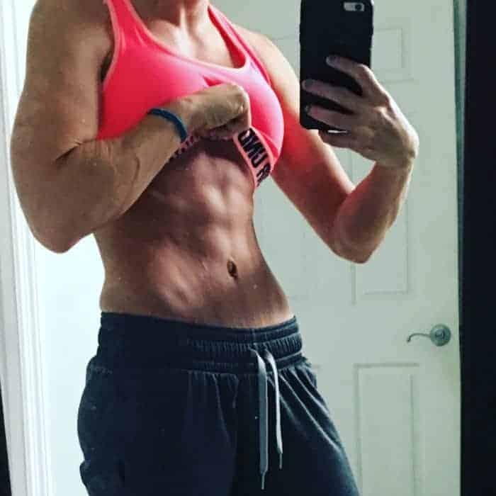 female keto dieter abs selfie